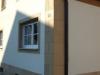 Sockel und Fensterumrahmung als Sandsteinimitation